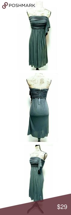 """J.Crew Strapless Dress Super cute jersey knit strapless dress by J.Crew. Color dark grey. Size O. Zips in back. Approximate measurements laying flat: length 33"""" bust 13"""", waist 11"""". Elastic at waist. Excellent pre-owned condition. J.Crew Dresses Strapless"""