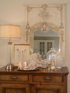 HGTV: Decorate an entry or hall table with a coastal vignette. Find one commanding object, like the antique mirror RMSer Lulu D uses here, and surround it with other accessories of varying scale, but similar style.