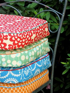 Patio cushions are a great way to pull the colors in the garden onto the porch or patio