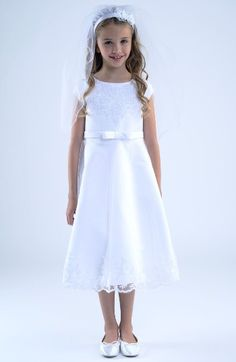 Free shipping and returns on Us Angels Embroidered A-Line Dress (Little Girls & Big Girls) at Nordstrom.com. Intricate embroidery details the neckline and flared skirt of this beautiful A-line dress that's perfect for her special day. A pretty bow at the waist adds a charming finishing touch.