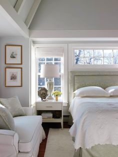 New England Home - Traditional bedroom with damask fabric headboard