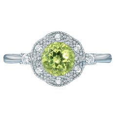 August's birthstone: The symbol of emotional balance and said to help one heal. Sterling silver ring with a gorgeous round center 3/4 ct. Peridot in a CZ embellished setting. Regularly $59.99, buy Avon Jewelry online at http://eseagren.avonrepresentative.com