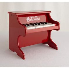 "Our little red piano is the perfect choice for your budding young Mozart.  The sound on the 18-key instrument is produced just like a regular piano ""with mini hammers striking precision-ground steel music rods. Details, details Steel music rods Removable educational color strip fits behind the keys to help kids learn piano Includes basic song book and color-coded learning stripAge range 3 and up."