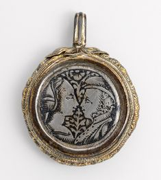 Pendant with facing couple (obverse) and sacred monogram (reverse), 15th century. Italy. The Metropolitan Museum of Art, New York. Gift of J. Pierpont Morgan, 1917 (17.190.965)