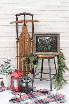 Christmas porch with antique sleigh and old sign chalkboard art. Love the natural garland! #christmastreedecoration
