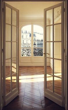 paris apartment. Gorgeous volumes, light and herringbone floorboards. Haussmann was a genius!