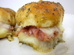 Hot Party Ham Sandwiches using King's Hawaiian Bread minis, deli ham/turkey, baby Swiss and warm ooey gooey goodness.