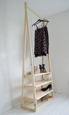 Valet Clothes Stand from CB2 The biggest dream I have for my house is turning the finished attic, complete with...
