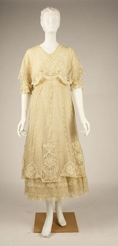 1910s Daytime Dress: This afternoon dress, from 1912, continues the Art Nouveau and Belle Epoque style with lace and flower details.