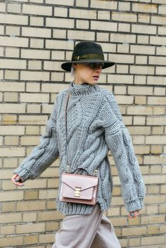 Linda Tol | Note that the bag and hat update this sweater and slacks look.