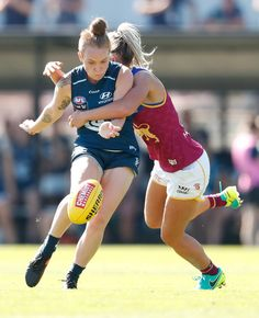 Tilly Lucas-Rodd of the Blues is tackled by Kaitlyn Ashmore of the Lions during the 2017 AFLW Round 07 match between the Carlton Blues and the Brisbane Lions at Ikon Park on March 19, 2017 in Melbourne, Australia.
