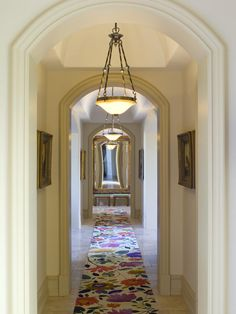 """Nice hallway """"doubled"""" by mirror at far end. Lovely lights. Don't like the runners."""