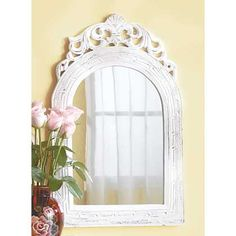 "Wood-framed vintage-look mirror adds French Provincial flair to your ""chateau""! Weathered white finish is a fabulous fit for any color scheme."
