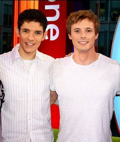 Colin Morgan and Bradley James. OMG they are super cute I can't figure it out! I think it's Colin's hair and that they are both wearing white(:
