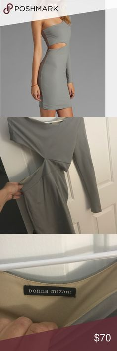 Small grey one sleeve dress I can't find a pic of me wearing this dress on my phone but the first pic is the dress on someone online. It has one sleeve and a cut out on the opposite side. The sleeve is on the left. I wore it once to a party and it's been in my closet since 2013. donna mizani Dresses One Shoulder