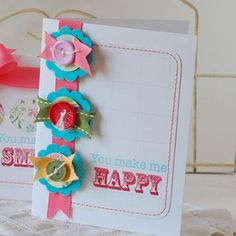 And also how I made the cute little flower embellishments on this card using some scraps of ribbon.  If you're like me, you have a whole jar full of ribbon bits that you can't bear to part with