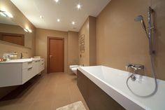 Long Bathroom With White Floating Vanity