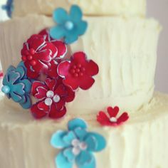 Strawberries & cream cake, finished with white chocolate ganache. The sugar flowers were made to resemble the enamelled brooches the bride had made into her bouquet. #weddingcakes #red #aqua #sugarflowers www.gillianbellcake.com.au