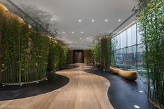 Woods Bagot's Shanghai studio recently completed the interior fit-out of the educational facilities at the Chinese headquarters for the Tang Foundation. Interior Fit Out, Interior Garden, Office Interior Design, Office Interiors, Interior Design Living Room, Lobby Interior, Retail Interior, Luxury Interior, Interior Architecture