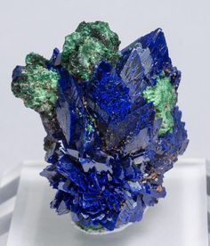 Azurite with Malachite and Baryte | #Geology #GeologyPage #Mineral Locality: Oumjrane mining area Alnif Tarhbalt Er Rachidia Province Meknès-Tafilalet Region Morocco Specimen size: 4.3 3.5 2.7 cm Main crystal size: 0.9 0.8 cm Photo Copyright Fabre Minerals Geology Page www.geologypage.com