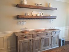 DIY floating shelves with wine glass storage over buffet in dining room