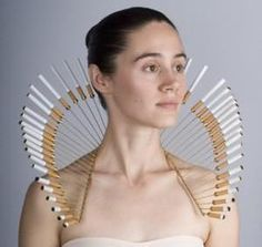 This done in clock hands and worn in addition to the neck corset would be stunning!