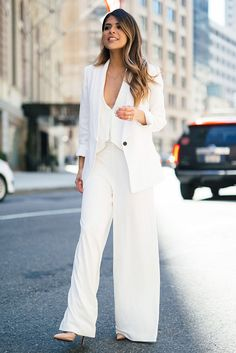 See the week's most inspiring street style spring / summer outfits, from extra-long sleeve ensembles to edgy light layers. Get the looks here!