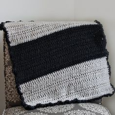 Make a simple crochet blanket for the little one in your life with this free pattern. Makes the perfect shower gift or welcome home present!