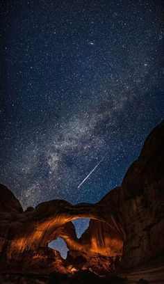 This photograph was taken in the Arches National Park, Utah, during the annual Perseid meteor.