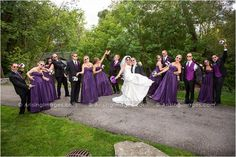 Fun bridal party photo with props and goofy poses.