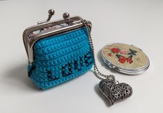 "I got this lovely, very good quality frame from https://emmalinebags.com/products/small-sew-in-rectangle-purse-frame and decided to make another ""Love"" coin purse. Because the frame is a bit smaller (7.9cm) than stated in pattern i did adjust fabric lining seam sides (see pic), sewed 13mm away from edge instead of 10mm. Then fabric sitted inside very well. As I used blue King Cole DK yarn I didn't double it up but used 3mm hook and it matched the pattern t..."