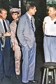 Congressman John F. Kennedy talks with workers at the Watertown Arsenal, Watertown, Massachusetts. Colorized by Steve Smith