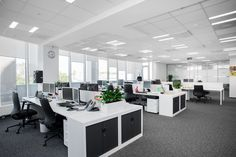 European bank in Moscow office interior design by Meandre. Office open space in white.
