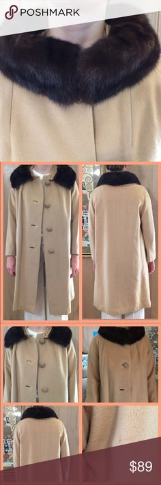 Vintage Cashmere Swing Coat w/Mink Collar Med. Size Medium (go by measurements).  This 100% cashmere camel swing coat is absolutely stunning. The pictures can't even do it justice. The lining is absolutely perfect with no tears.  It was designed by Michel Daniel from Paris France. Mink collar is attached. Wear the coat open for one a look or close it and becomes a true collar. all buttons intact. 3/4  sleeves and front inset pockets. No holes or stains. One mark under left arm but not…