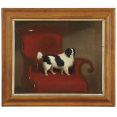 """British School (Fourth Quarter 19th Century), """"Black and White Spaniel in a William IV Chair"""", oil on canvas, unsigned. Presented in a birds-eye maple frame with a silvered liner. England. Fourth Quarter 19th Century. LENGTH: 14 in. (36 cm)  HEIGHT: 17 in. (43 cm) -  George Davis Antiques & Interiors, Savannah, GA"""