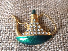 Emerald Green & Gold Genie Lamp Brooch Pin. $8.00, via Etsy.