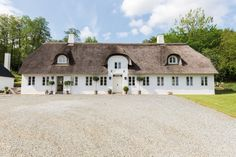 The Dinesen Family House: A Historic Renovation for Danish Design Royalty - Remodelista Thatched House, Thatched Roof, Hygge, Danish Country, Danish House, Architecture Résidentielle, Nordic Design, Scandinavian Home, Danish Modern