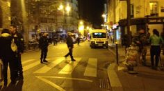 French police officials and witnesses have reported an explosion in a bar near a Paris stadium, a shootout outside three Paris restaurants and a hostage situation in a concert hall, leaving at least 40 dead.