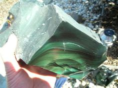 Green Obsidian is one of Obsidian Rocks that contain impurities as Pure obsidian usually appears to be dark, although the color may vary depending on the presence of impurities. Minerals And Gemstones, Crystals Minerals, Rocks And Minerals, Stones And Crystals, Gem Stones, What Is Green, Gem Hunt, Rock Hunting, Amazing Greens