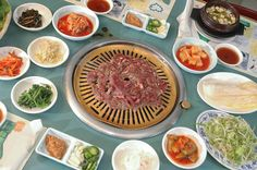 Korean BBQ at home. Thinly sliced steak or pork belly, your favorite veggies, like bean sprouts, squash, jalepeno, garlic cloves, onions, some kimchi and rice paper. Use a griddle and go crazy! :)