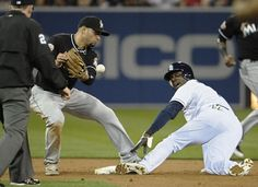 Game #27 5/4/2012: Orlando Hudson #1 of the San Diego Padres steals second base as Omar Infante #12 of the Miami Marlins bobbles the ball during the third inning of a baseball game at Petco Park on May 4, 2012 in San Diego, California. (Photo by Denis Poroy/Getty Images)