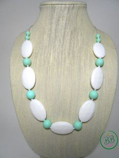 Gorgeous Handmade Silicone Teething/ Nursing Necklace featuring BPA-free, food-grade silicone beads. This necklace was designed with mama AND baby in mind; fashionable and safe to chew on and play with. Fully customizable and makes wonderful gift for that new mama in your life!