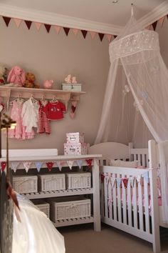 "super cute way to do bunting along the top moulding or even if doing a half wall fabric decor, nice way to ""finish"" it."
