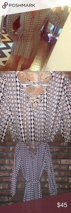 Long sleeve tunic dress Long sleeved tunic dress with black tan and salmon geometric pattern. Belted waist and criss cross neckline and back. Never worn. From boutique. Lumière Dresses Long Sleeve