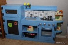 I have just fell in love with this play kitchen. Ilove how compact it is, with all the functionality of a real kitchen! Will definately be making this for her bday!