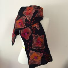 Hand felted scarf using Australian Merino wool and embellished with beautiful orange/pink silk hankies to add a gorgeous lustre to the black wool