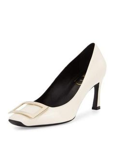 """Roger Vivier smooth leather pump. 2.8"""" covered heel. Square toe. Signature logo buckle detail. Tonally topstitched collar. Slip-on style. Smooth sole. """"Trompette"""" is made in Italy."""