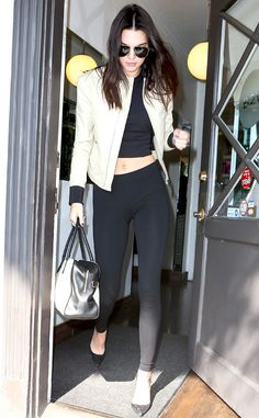Leggings Love from Kendall Jenner's Street Style  Back in Los Angeles after the Cannes Film Festival, Ms. Jenner steps out in a comfy pair of lack leggings, a cropped top and beige bomber jacket.