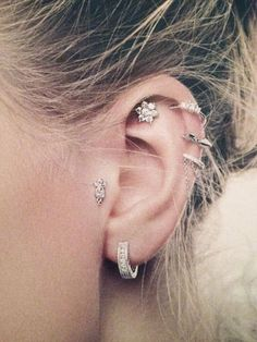 I love the piercings. I feel like the lobe should have more, though...a small stud or two maybe.