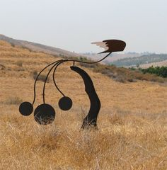ROMERO METAL ART - Artist Dan Romero kinetic wind / balance sculpture